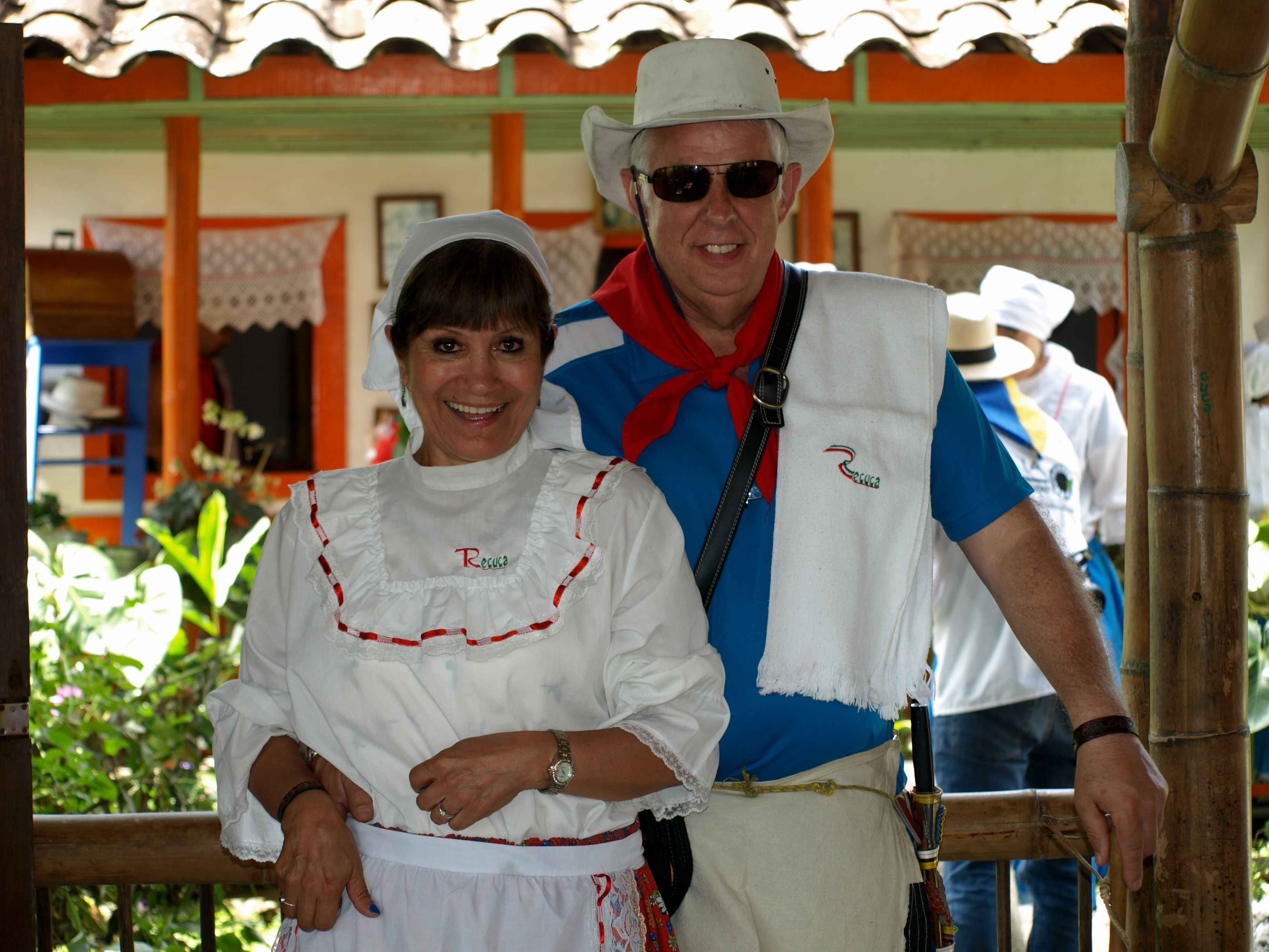 Cristina and Mike in traditional coffee growers outfits