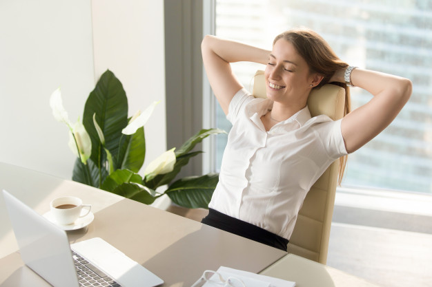 businesswoman having positive feelings about work.