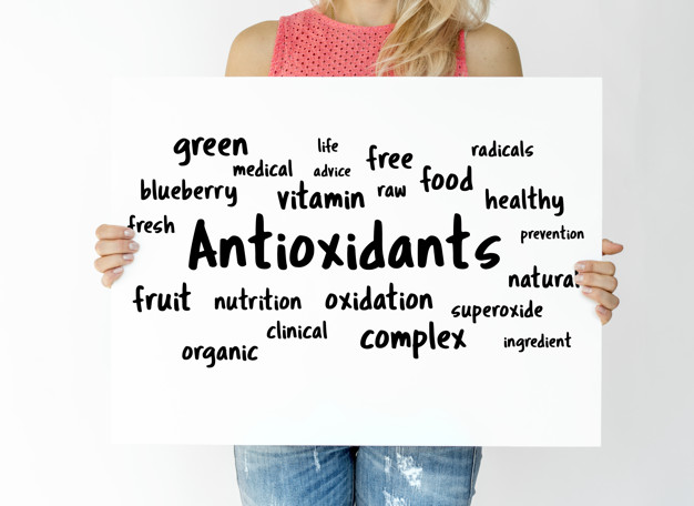 A woman holding board with antioxidants concept.